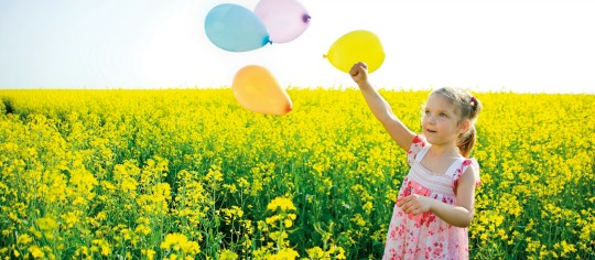 Girl with Balloons on a yellow field